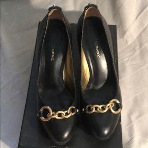 Banana republic black with gold metal ring pumps.